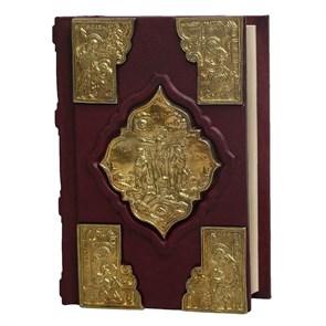 Святое Евангелие в кожаном переплете с литьем